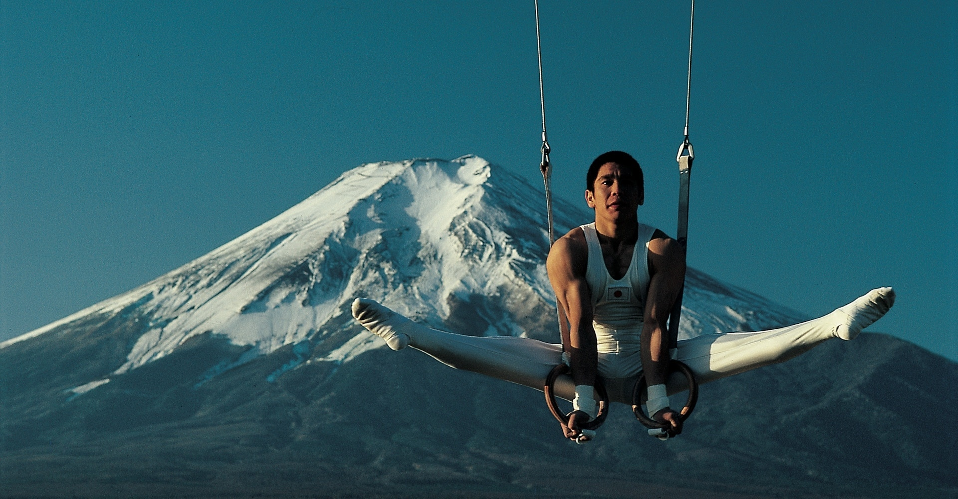 Koji Gushiken on rings in front of Mount Fuji, Japan.