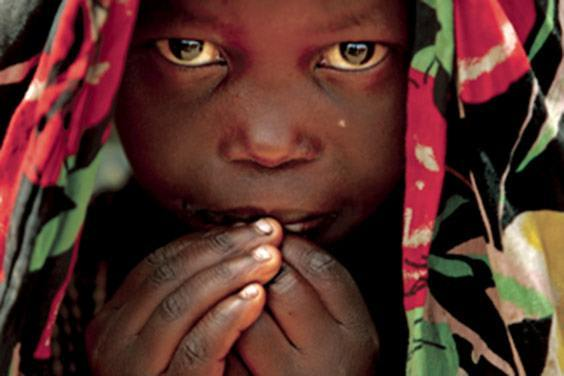 A girl looks on at a refugee camp near a United Nations peacekeepers camp in Kiwanja, Congo, on November 8, 2008.