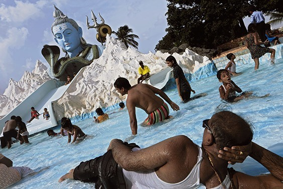 India, 2009  Shiva lords over Suraj Water Park near Mumbai, where locals enjoy the universal pleasure of swimming and splashing on a hot day. Recreation commands a growing share of the world's water use.