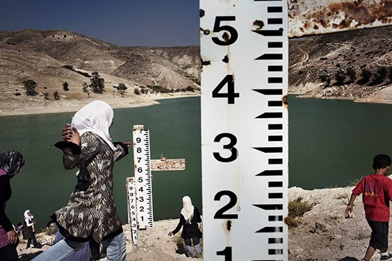 Jordan, 2009  After six years of drought, measuring sticks are useless at Jordan's Ziglab Dam, built to catch water flowing west into the Jordan River for irrigation. Its reservoir has shrunk to a fifth of capacity and has not filled since 2003, forcing Jordan to ration water.