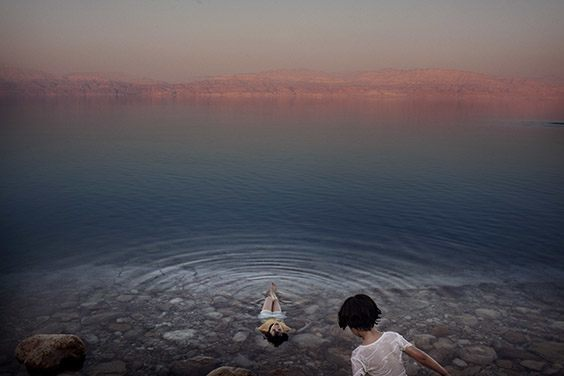 Israel, 2009  Girls from a West Bank village cool off in the briny waters of the Dead Sea, the world's deepest saltwater lake. Naturally buoyant waters make it a favorite of bathers. Yet levels are dropping more than three feet a year.