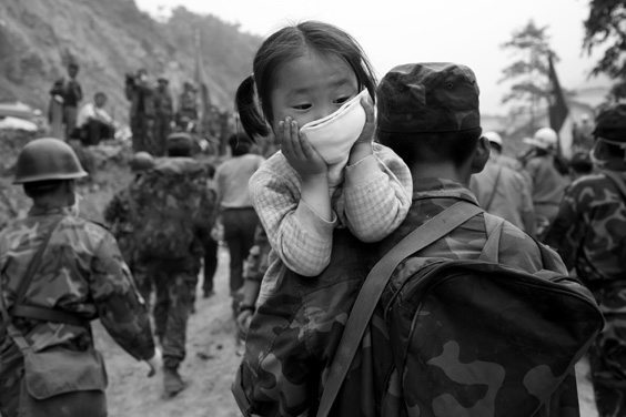 Days after the devastating earthquake that killed thousands of people in this valley town of Beichuan, Sichuan Province, China, rescuers were still searching for survivors and collecting bodies.