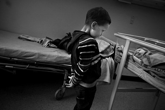 Felix meets his new little sister, Emma Richardson, on February 26, 2009. He has helped his mother choose her first outfit: cowboy pajamas. Felix, like his older brother Mathias, has a genetic disease that progressively destroys the brain. Mathias is now deaf and paralyzed and cannot speak. While Felix shows no outward signs of the disease yet, one hope for his survival is Emma, who his parents selected to have the exact right genes. Stem cells taken from the umbilical cord at the time Emma's birth may save Felix if the disease breaks out.