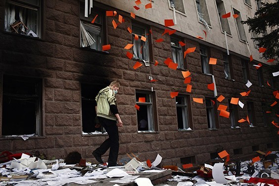 Papers fall out of the windows of the parliament building as rioters ransack the inside in Chisinau, Moldova, on April 7, 2009. Demonstrators had stormed the building to protest the victory of the governing Communist Party in the general election two days earlier. Opposition leaders accused the Communists of rigging the elections and demanded a recount. More than 30 people were injured in the protests and three demonstrators died in police custody under mysterious circumstances. The poorest country in Europe, Moldova is the only former Soviet state to vote the Communist Party back in power through democratic elections.