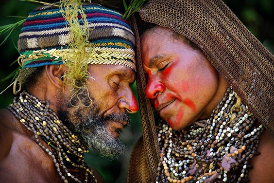 Central highlands of Papua New Guinea A man and woman share an intimate moment during a courtship ritual in the central highlands of Papua New Guinea.