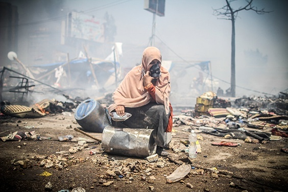A female supporter of ousted president Mohamed Morsi reacts during the violent dispersal of of Rabaa square where thousands of Islamists had camped in protest to the military coup and calling for the return of Morsi. The Rabaa massacre left over 1000 killed according to HRW and other rights group, making it one of the bloodiest days in Egyptian modern history. Cairo, August 14, 2013.